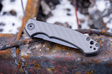 A small pocket knife. The knife on the rusty iron. Top. Stock fotó