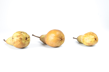 Inverted pears. The bottom view of the pear. Lined up in a row. Foreground.