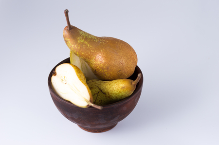 Still life of pears. Sliced pear in a deep plate. Pears are a rural type. Stock Photo