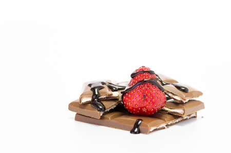Fresh strawberries sprinkled with chocolate. Strawberry chocolate. Isolate