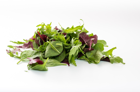 Set of greens for salad. Vegetable salad on a white background. Front view.