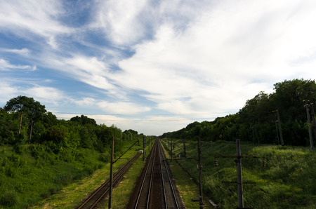 The leading road. Railway. A long way. Blue sky with clouds. Stock Photo