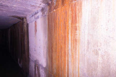 The wall is flooded with rust. The walls are grim and gloomy. Tunnel. Stok Fotoğraf