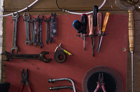 Wall with tools. Board with tools. Old tools. Background with tools.