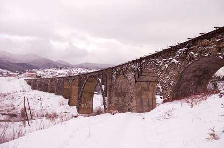 Bridge and many arches. The passage in the form of arches. Mountain landscape.