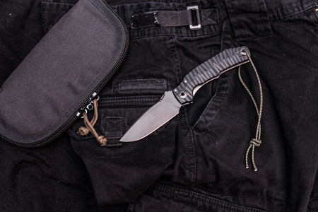 Military set. Military composition. Knife and organizer. Stockfoto