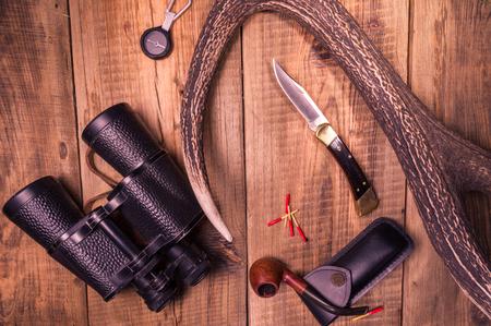 Things hunter. Knife and binoculars hunter. Binoculars and compass tracker. View above. Stock Photo