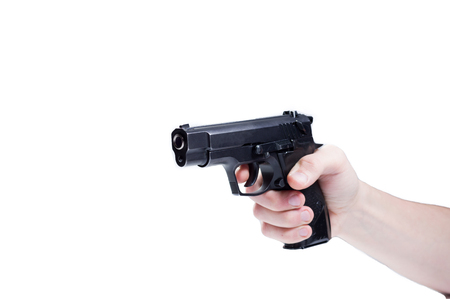 Pistol in hand. Isolate gun in hand. Pointing a gun. White background.