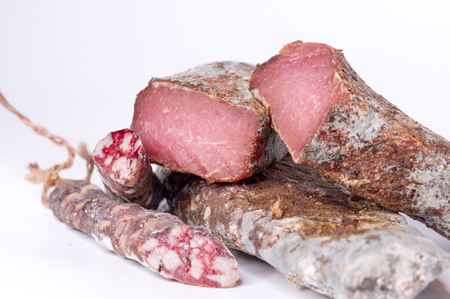 Meat platter. Meat and sausage. Dried meat with mold. Front view. Archivio Fotografico