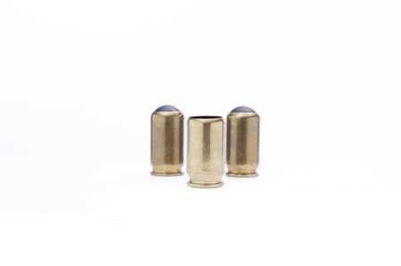 Ammunition for traumatic weapons. Three bullets with a rubber bullet. Isolate.