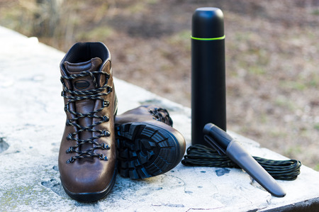 Footwear for tracking and hiking. Knife, thermal and paracord. Outdoor set.