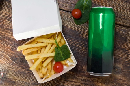 A serving of french fries and vegetables. Potatoes and beer.