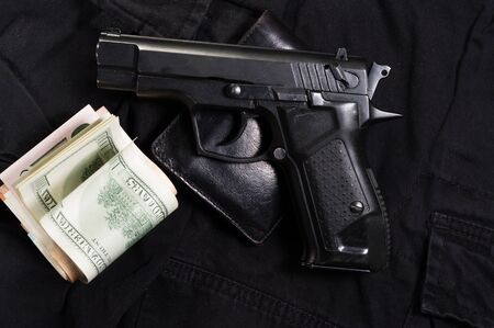Black gun and black purse. Buying a weapon. Top.