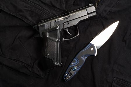 View from the top of the knife and the gun. Makarov's gun and knife.
