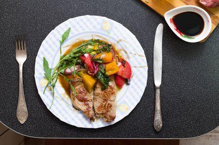 Dish with pork steak. Steak and appliances. Steak sauce. 写真素材