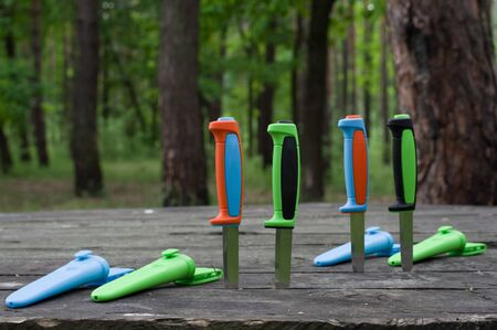 Multi-colored knives plastic cases. Knives with colored handles and covers. Front view. 版權商用圖片