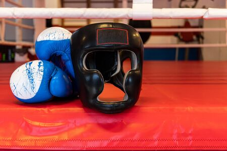 Boxing gloves and helmet. Boxing helmet for training. Boxing hall.