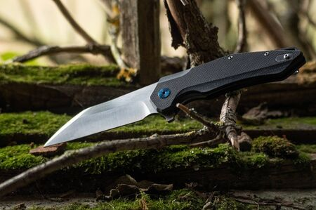 Foldable pocket knife for everyday use. With a knife in nature.