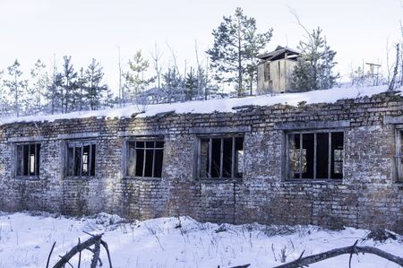 A farm covered in snow. The room is without windows. Brick farm.