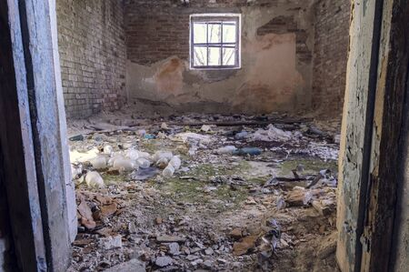 Old brick room. Room with a window. Abandoned room. Scary room. Trash and mess.