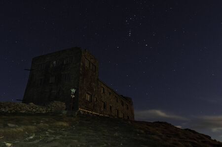 Fortress on the background of stars. Castle on a background of stars. Observatory. Mount Pip Ivan, Carpathians, Ukraine.