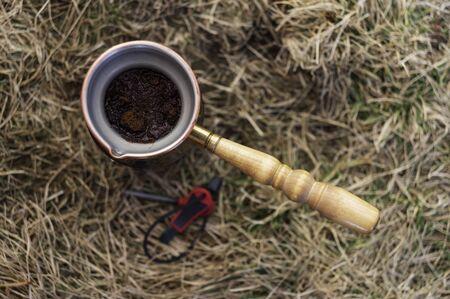 Making coffee in turk. Brew coffee in a turk. Cooking coffee in nature in turk.