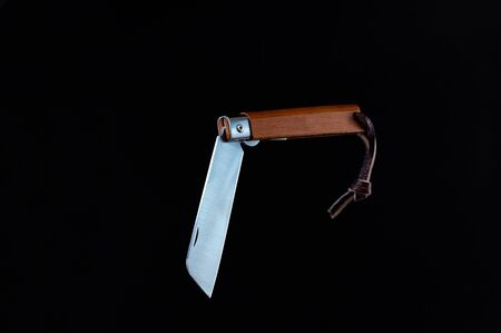 The knife is in a bent position. Knife with a blunt edge of the blade. Isolate.