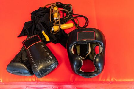 Boxing helmet and gloves. Boxing bandages and a jump rope. Top.