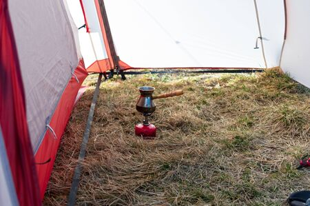 Making coffee in nurk. Making coffee in a tent.