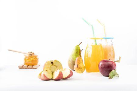 Sliced apple and a jar of honey. Autumn fruits. Reklamní fotografie
