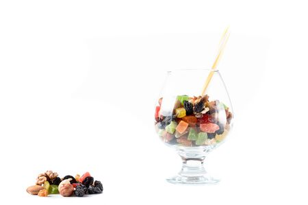 Mix of nuts and dried fruits. Glass with nuts and fruits.