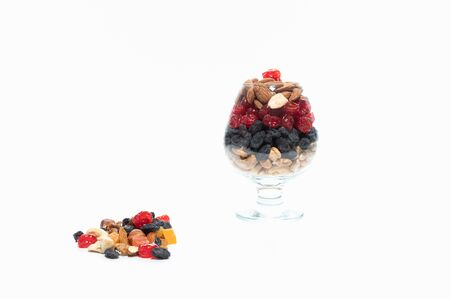 Mix of black and red berries. Useful berries in a glass bowl. Reklamní fotografie