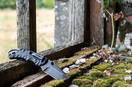 Pocket knife with a bottle opener. Knife and opener.