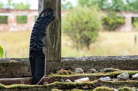 Sharp compact knife. The knife is upright. Reklamní fotografie