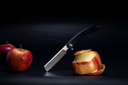 The apples are peeled. Peeling apples with a knife. Sad apples.