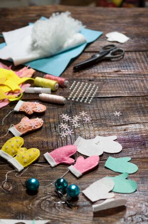 New Years toys and snowflakes. Preparation for the holiday. Vertical frame. Reklamní fotografie