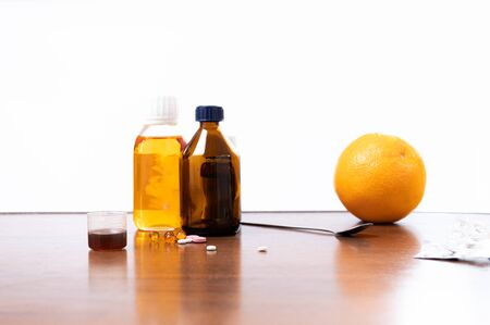 Medicines and an orange. Ethnoscience. Home treatment. Combined treatment for colds.