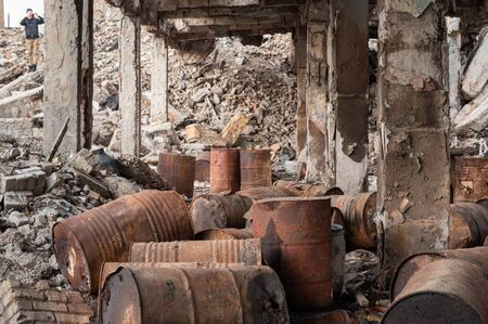 A lot of old gas barrels. Oil barrels. Abandoned basement. Disaster and ruins.