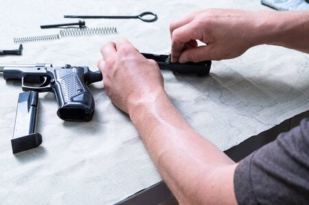 Assembly and disassembly of the gun. Details of the gun and hand. Cleaning the shutter frame.