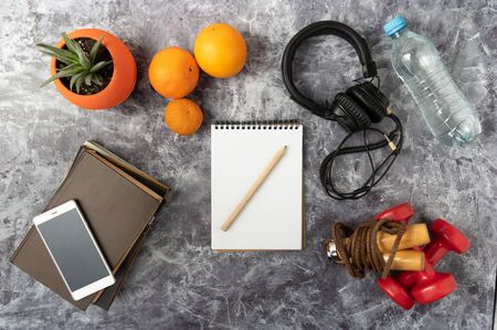 A set of items for fitness. Athlete's schedule and food. Flat lay.