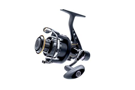 Black fishing reel on a white background. Fishing tool. Isolate. Imagens