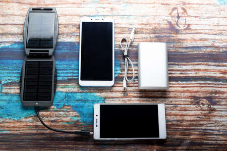 Universal charger for smartphones. Solar panel and power bank. Top.