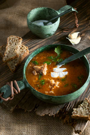 Serve soup with garlic and bread. Soup with sour cream.