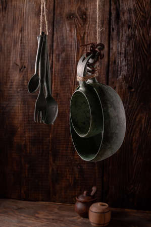 A set of kitchen appliances from eco materials. Recycled bowls and cutlery. Dishes against the wall. 版權商用圖片
