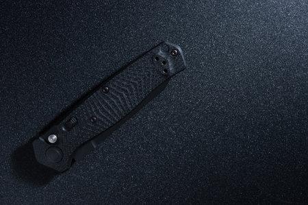Pocket black knife folded. Pocket knife for daily use. Top.