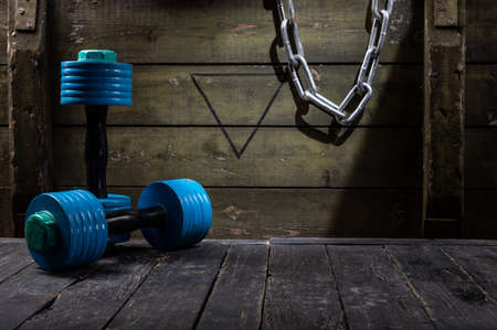 Sports typesetting dumbbells and iron chain. Sports simulator.
