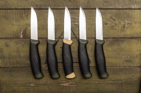 A unique knife among the many. The knife is different from other knives. Different knives.