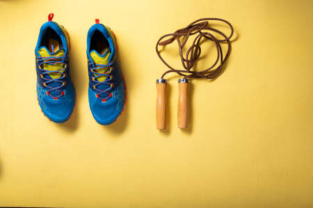 Sports sneakers and skipping rope. Cardio on a rope. Rope exercises.