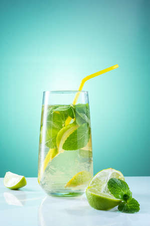 Lime and mint drink. Cocktail with mint and lime. A straw in a glass with a cocktail.