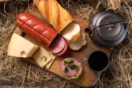 Prepared tea and sandwich. Lunch in the barn. Teapot and sandwich. Фото со стока
